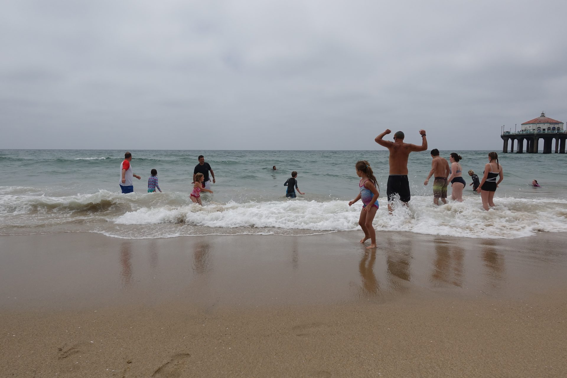 People playing in the Pacific Ocean at Manhattan Beach