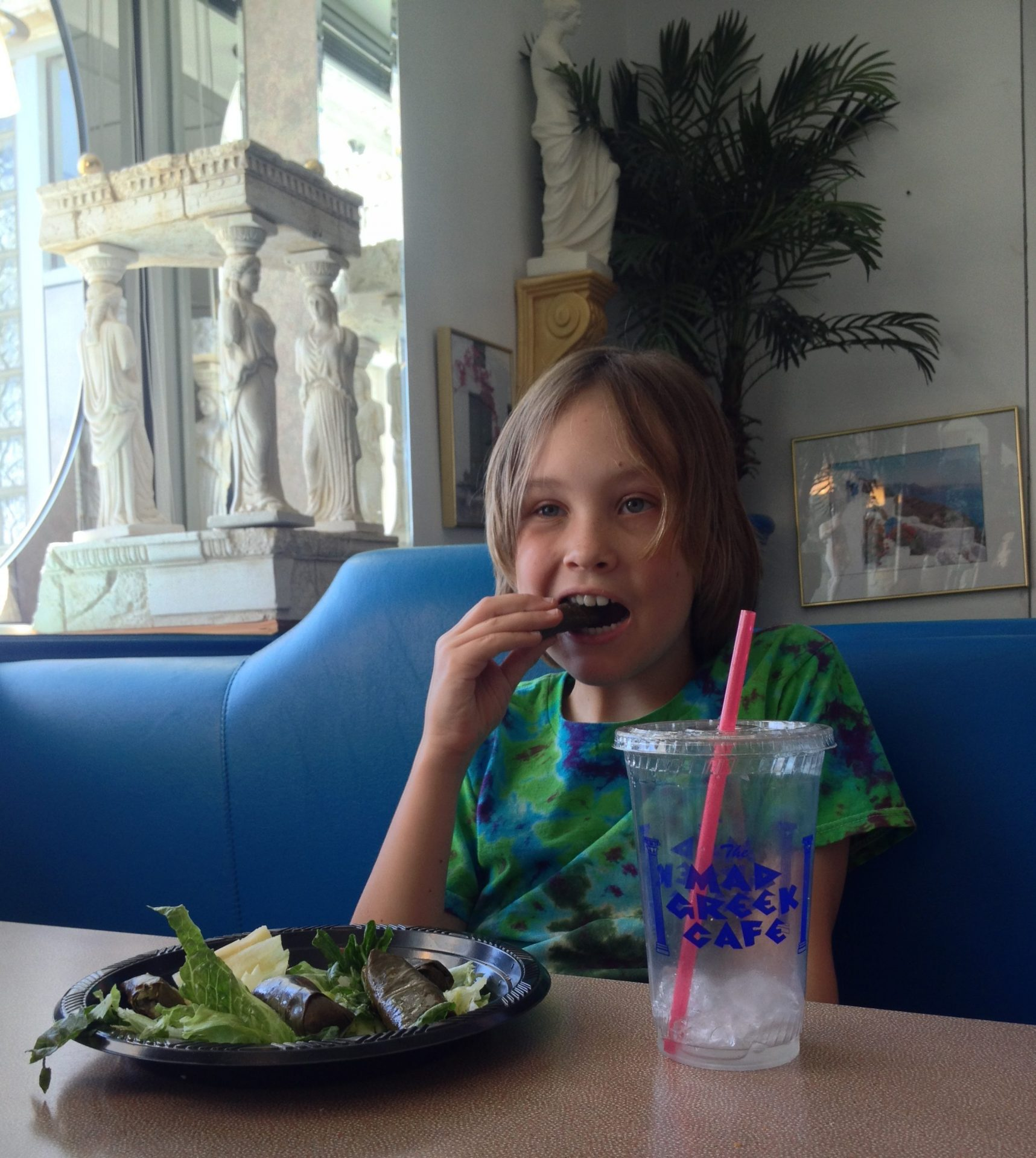 Eating dolmas at The Mad Greek