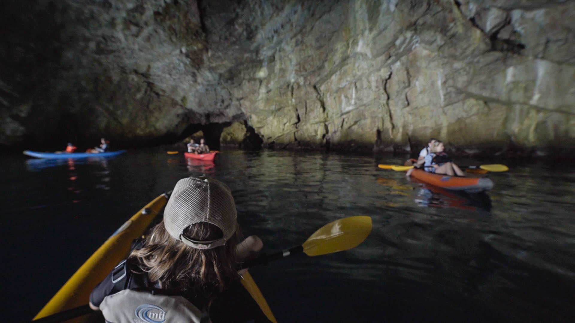paddling in the blue cave while kayaking in kotor