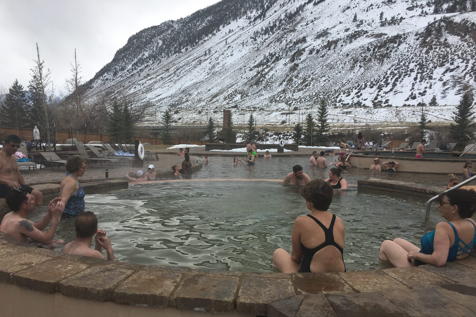 People soaking at Yellowstone Hot Springs, one of many Montana hot springs