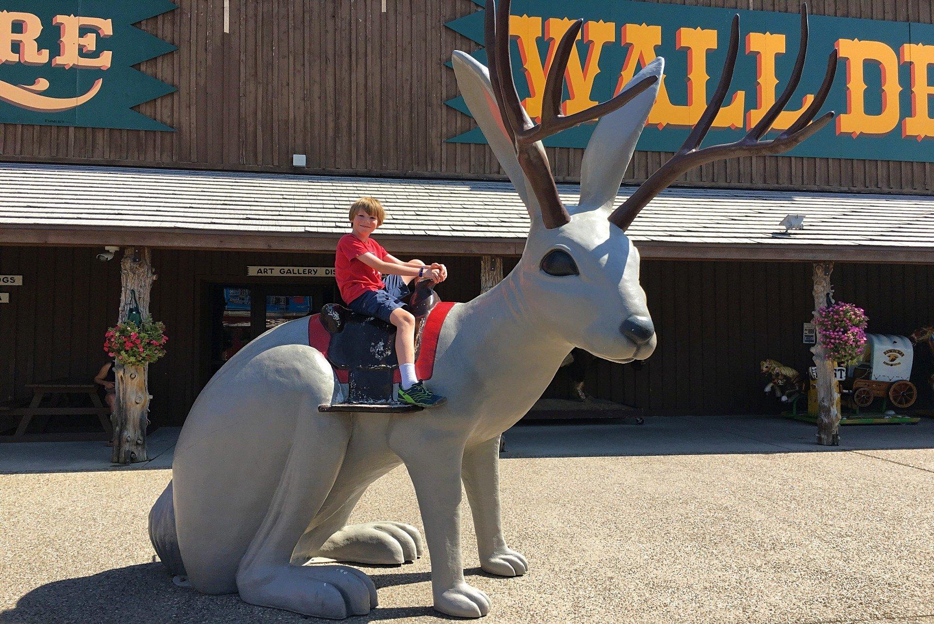 Riding a jackalope at Wall Drug South Dakota