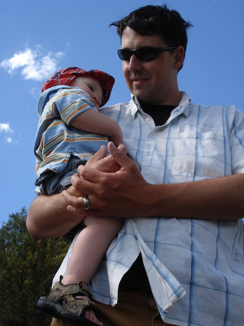 Anders snuggles with dad at Pto. Pañuelo